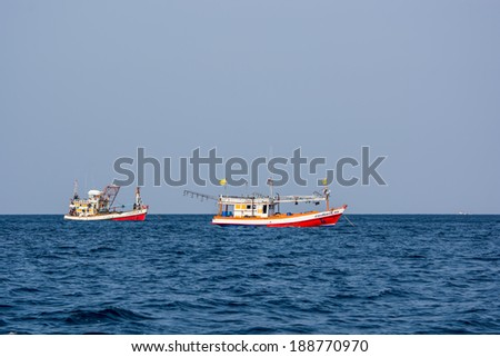 KRABI,THAILAND-MARCH 28,2014:The Old fishing boats running in the Andaman sea of Phi Phi island bay in Krabi Thailand.