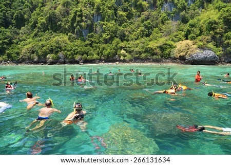 Krabi,Thailand-March 16, 2015: Tourists enjoy snorkeling in a tropical sea at Phi Phi island in Krabi, Thailand - stock photo