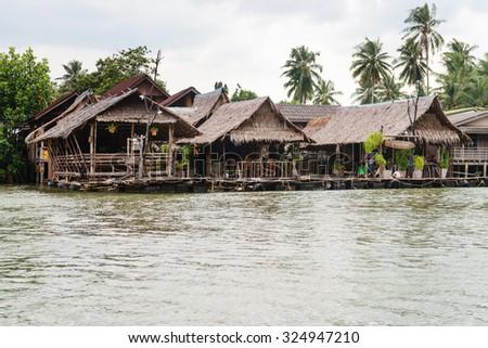 KRABI, THAILAND - 14 OCT 2014: Traditional Thai seafood restaurant on stilts over the water in Krabi, Thailand. - stock photo