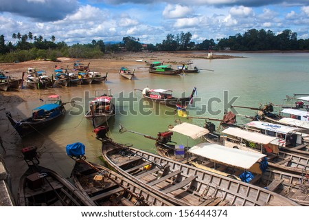 KRABI, THAILAND - SEP 5: Typical long tail boats on Sep 5, 2013 in Krabi province, Thailand.The long-tail boat is a type of watercraft native to Southeast Asia, which uses a common automotive engine.