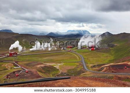 Krafla Lake neighborhood. Summer Iceland. Steam rises above the hot ground - stock photo