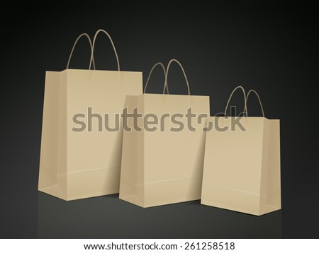 kraft paper bag set isolated on black background - stock photo
