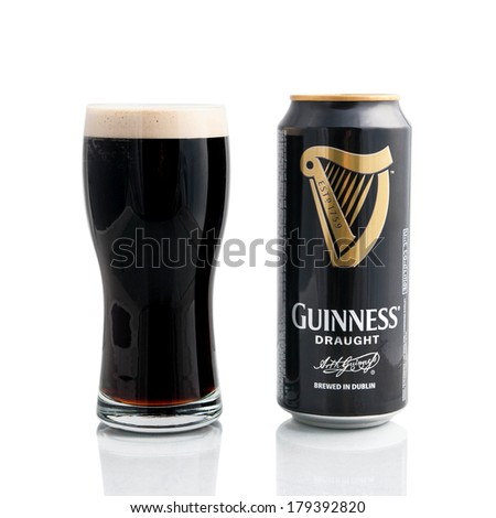 KRAGUJEVAC, SERBIA - February 28, 2014: Guinness draught on white background. Guinness is a popular Irish dry stout originated in the brewery of Arthur Guinness at St. James's Gate, Dublin in 1759. - stock photo