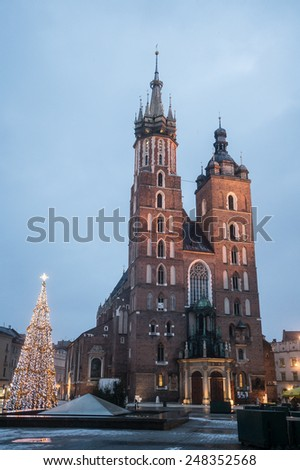 Krakow in Poland at dawn. St Mary's Basilica (Mariacki Church)  on Main Square in the Old Town. - stock photo