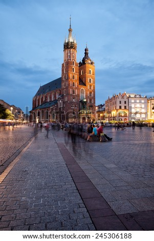 Krakow in Poland in the evening. St Mary Basilica (Mariacki Church, Bazylika Mariacka) on Main Square in the Old Town. - stock photo