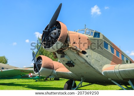 KRAKOW MUSEUM OF AVIATION, POLAND - JUL 27, 2014: old bomber aircraft on exhibition in outdoor museum of aviation history in Krakow, Poland. In summer often airshows take place here.