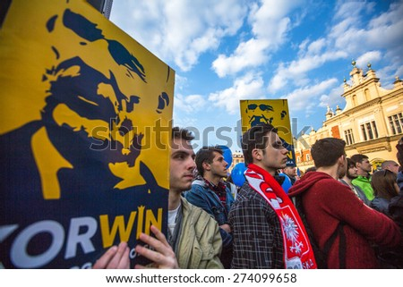 KRAKOW, POLAND - APR 29, 2015: During the rally of the presidential candidate of Poland - Janusz Korwin-Mikke - creator of a Polish liberal political party Coalition for the Renewal of the Republic. - stock photo