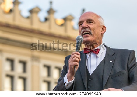KRAKOW, POLAND - APR 29, 2015: Janusz Korwin-Mikke or JKM, is a conservative liberal Polish politician, during pre-election rally of presidential candidate of Poland, on main square Krakow. - stock photo
