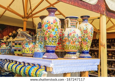 KRAKOW, POLAND - APR 13: tall vases made of porcelain on market stands in Krakow on 13 Apr 2014, Poland, Many tourists visit Krakow during Easter festival and buy traditional products.