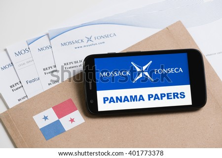 KRAKOW, POLAND - APRIL 6, 2016 : Folder with Mossack Fonseca logo and printed documents from it's web site and phone with Mossack Fonseca logo and Panama Papers text. - stock photo