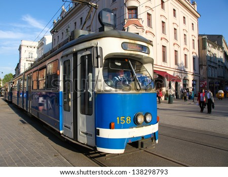 KRAKOW, POLAND - APRIL 26: Tram on Franciscanska street, in Krakow, Poland on April 26, 2011. Tramway is the primary form of public transport in Krakow.