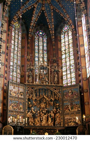 Krakow, Poland - August 13, 2011: Interior of the St. Mary's Basilica. In front of this building  the largest Gothic altarpiece in the World - The Altarpiece of Veit Stoss , made in 1477-1489.  - stock photo