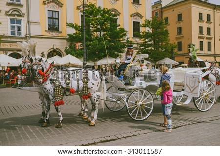 KRAKOW, POLAND - AUGUST 22, 2015: People in Main Market Square of the Old City in Krakow in Poland at Summer day