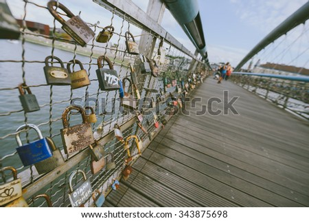 KRAKOW, POLAND - AUGUST 22, 2015: The Kladka Bernatka- bridge of love with love padlocks in Krakow, Poland.