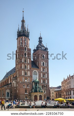 KRAKOW, POLAND/EUROPE - SEPTEMBER 19 : St Marys Basilica in Krakow Poland on September 19, 2014. Unidentified people.