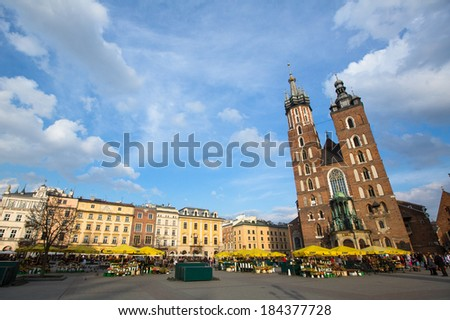 KRAKOW, POLAND - FEB 28, 2014: St. Mary's Church in historical center of Krakow. This year the city was visited more 8 million tourists, which is the highest level.