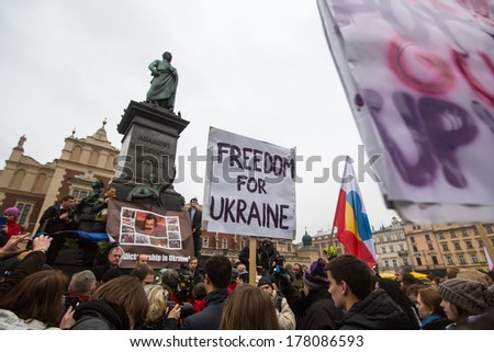 KRAKOW, POLAND - FEB 22, 2014: Unidentified participants during demonstration on Main Square, in support of Independence Ukrainein and against the killing of protesters in Kiev.
