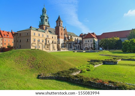 Krakow, Poland. Gardens near Wawel Castle with the blue sky in the background