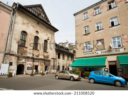 KRAKOW, POLAND - JUL 31: Old houses with restaurants in old street of jewish quarter Kazimierz on July 31, 2014 in Eastern Europe. Since the 14th to the 19th century Kazimierz was an independent town