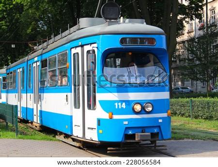 KRAKOW, POLAND - JULY 8, 2014: Old blue tram in downtown Krakow - stock photo
