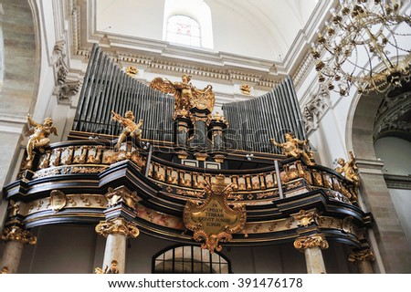 KRAKOW, POLAND - JULY 2, 2009: The organ at Saints Peter and Paul church with golden colored statues and ornaments