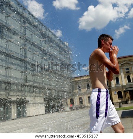 KRAKOW, POLAND - JULY 3, 2016: Youth seeking escape from the summer heat in Cracow, Poland