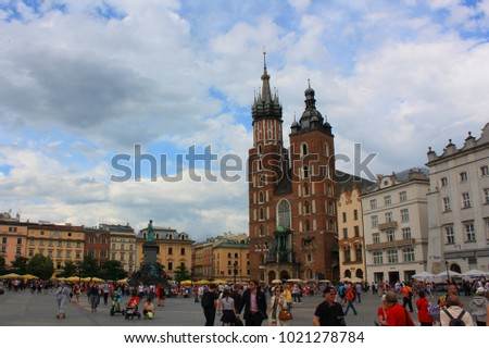 Krakow, Poland - June 15, 2016. Church of St. Mary on the main Market Square (Rynek Glowny) in the city of Krakow