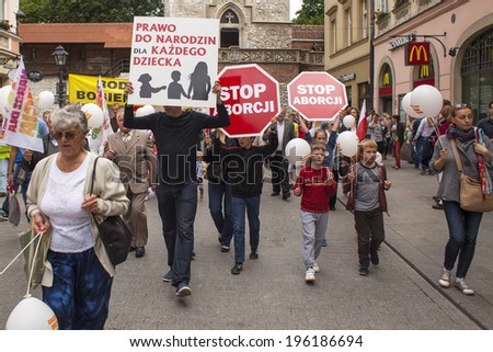 KRAKOW, POLAND - JUNE 1 , 2014 : Rally against abortion in defense of life and family. Inscriptions on a banners : Stop abortion, the right to be born each child etc. - stock photo