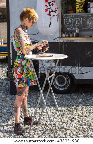KRAKOW, POLAND - JUNE 12, 2016: Unidentified festival participant during the 11-th International Tattoo Convention in the Congress-EXPO Center of Krakow. - stock photo