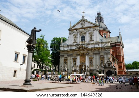 KRAKOW, POLAND - JUNE 16:Unidentified tourists visiting Church of St. Peter and Paul on June 16, 2013 in Krakow, Poland.Krakow is enlisted in the UNESCOs World Heritage List.