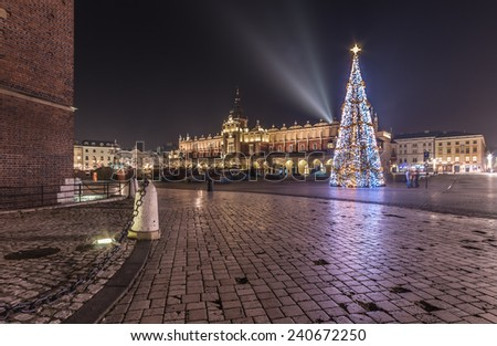 Krakow, Poland, Main Market square and Cloth Hall in the winter season, during Christmas fairs decorated with Christmas tree.  - stock photo