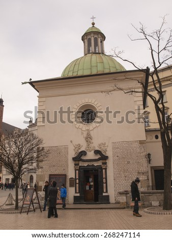 KRAKOW, POLAND - March 29, 2015: The Church of St Adalbert or the Church of St Wojciech of the Main Market Square and Grodzka Street in Old Town, Krakow, is one of the oldest stone churches in Poland. - stock photo