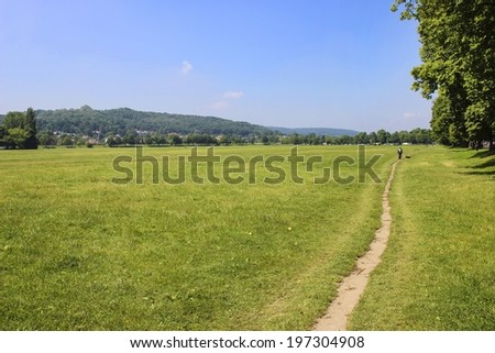 KRAKOW,POLAND - MAY 08, 2014: Blonia Park is a vast meadow with an area of 48 hectares directly adjacent to the historic centre of the city of Krakow.