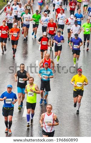 KRAKOW, POLAND - MAY 18 : Cracovia Marathon. Runners on the city streets on May 18, 2014 in Krakow, POLAND  - stock photo