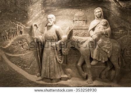 Krakow, Poland - May 16, 2013. Nativity scene carved from salt. Wieliczka Salt Mine in Krakow, Poland, Europe. Unesco heritage site. - stock photo