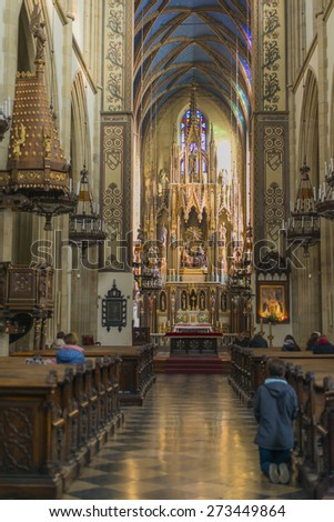 KRAKOW, POLAND - NOV 04, 2014: Holy Trinity Church. Prayer congregation. Built in 1250 by Dominican friars from Bologna. Picture taken while traveling in Poland. - stock photo