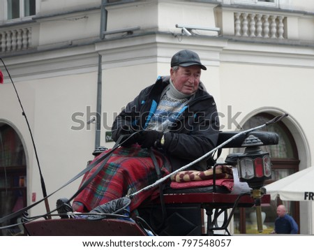 Krakow, Poland - November, 10, 2012:  coachman on the Market square.