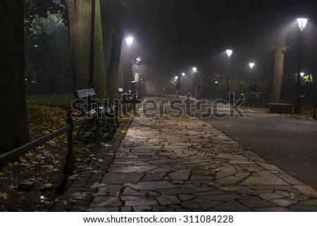 KRAKOW, POLAND - OCT 30, 2014: Planty - city park in Krakow, Poland. Picture taken in the evening during a trip to Krakow.