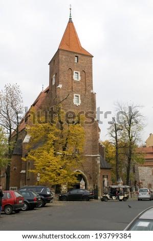 KRAKOW, POLAND-OCTOBER 13: Unidentified tourists visit The Church of the Holy Cross (Kosciol Swietego Krzyza) in popular tourist destinationof Krakow, Poland on October 13, 2013. - stock photo