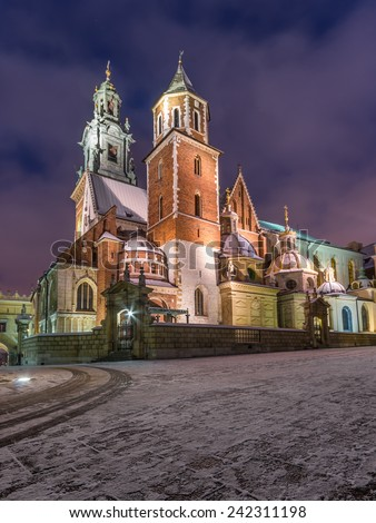 Krakow, Poland, royal cathedral on the Wawel Hill illuminated during winter night - stock photo