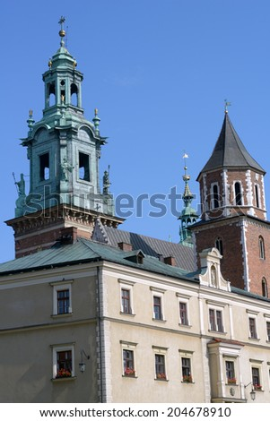 KRAKOW, POLAND - SEPTEMBER 15, 2013: Bell tower of the Wawel cathedral against sky. Originally built in XIV century, the cathedral is a most important burial place of Polish kings and national heroes