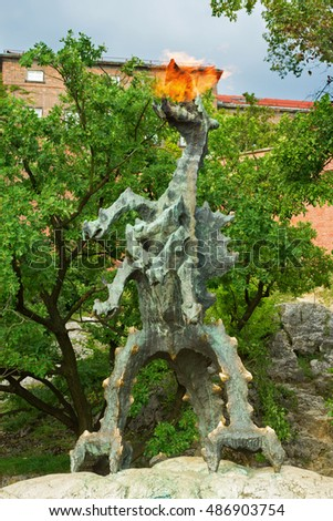 Krakow, Poland - 2 September, 2016: Statue of a fire breathing dragon near the Wawel castle.