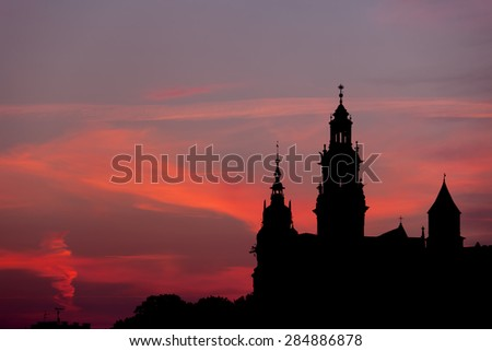 Krakow, Poland, Wawel Royal Castle and Cathedral towers skyline silhouette at dusk. - stock photo