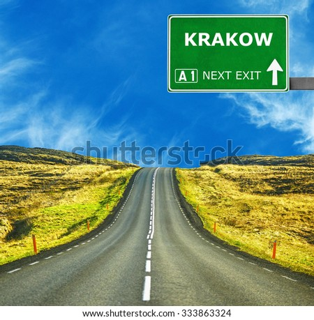 KRAKOW road sign against clear blue sky - stock photo