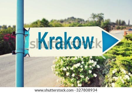 Krakow Road Sign with beautiful nature and road on background - stock photo