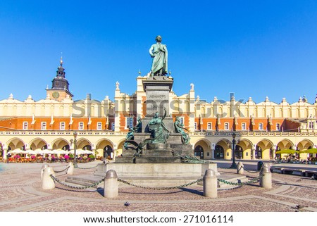 Krakow - the statue of Adam Mickiewicz on the main square in Krakow: the writing says: For Adam Mickiewicz - Nation, Poland - stock photo