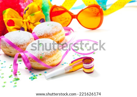 Krapfen or donuts with jam and icing sugar - stock photo