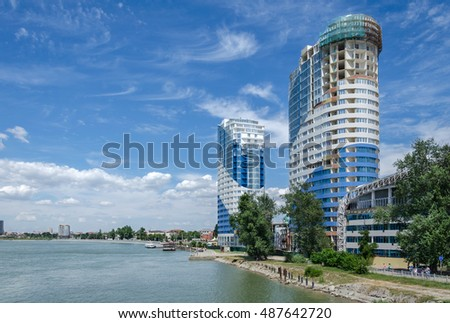 Krasnodar, Russia - July 03: Skyscraper and embankment along a river on July 03, 2016  in Krasnodar, Russia.