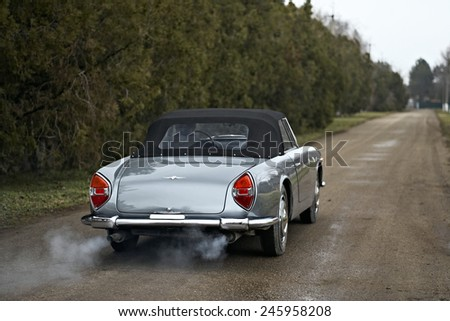 Krasnodarskiy region, RUSSIA - FEBRUARY 4: Lancia Flaminia Superleggera photo session near Krasnodar on february 4, 2013