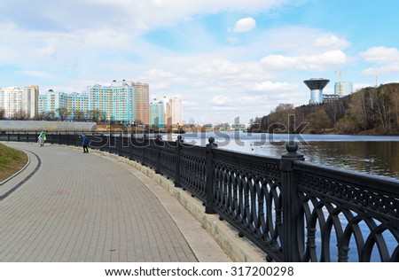 Krasnogorsk RUSSIA - April 22.2015: The Zivopisnaya promenade on the banks of the Moskva River. Location walking people. Area residential development is about 2 million square feet